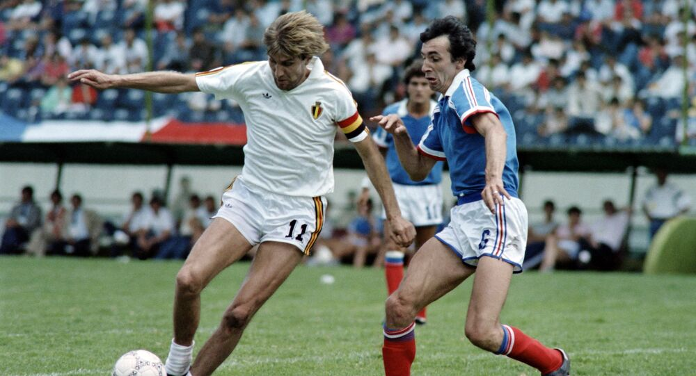 Belgium's Jan Ceulemans holds off France's Maxime Bossis in the third-place play-off at the 1986 World Cup finals