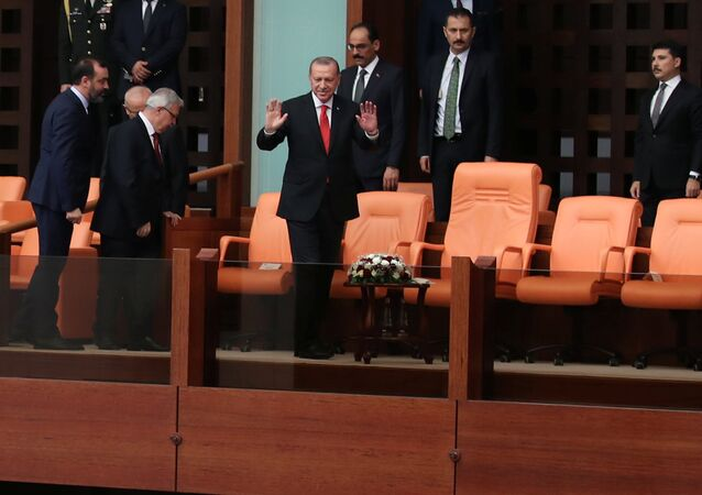 Turkish President Tayyip Erdogan greets deputies at the beginning of an oath-taking ceremony at the Turkish parliament in Ankara.