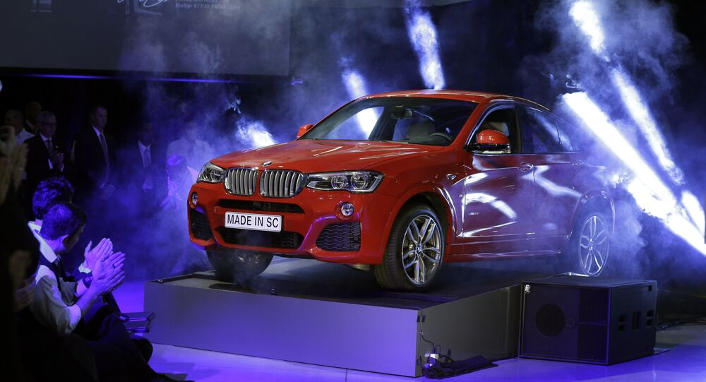 A new BMW X4 vehicle is unveiled during a news conference at the BMW manufacturing plant in Greer, S.C., March 28, 2014