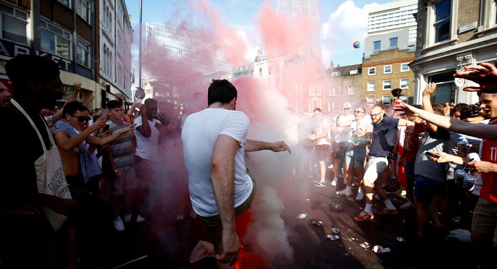 Soccer Football - World Cup - England fans watch Sweden vs England - London, Britain - July 7, 2018 England fans set off smoke bombs after the match
