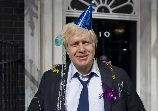 In this photo taken Friday, May 4, 2012 file photo, Madame Tussauds London mark Boris Johnson's victory in the London mayoral election by giving him a post-party makeover