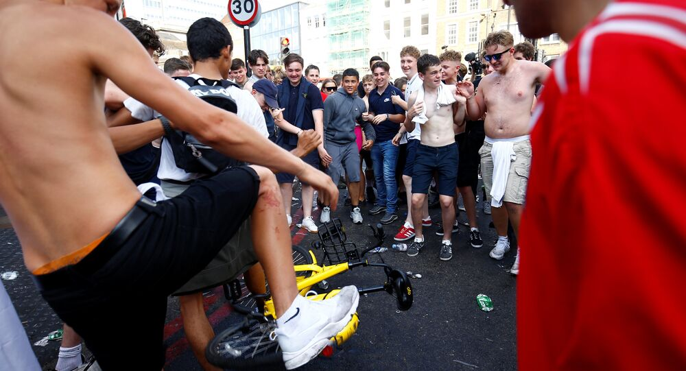 World Cup - England fans watch Sweden vs England - London, Britain - July 7, 2018 England fans stamp on rent bicycle after the match
