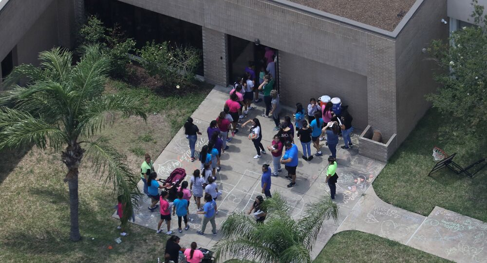 Migrant children make their way inside a building at Casa Presidente, an immigrant shelter for unaccompanied minors, in Brownsville, Texas, U.S., June 23, 2018.