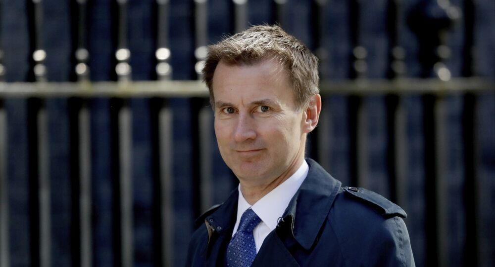 Britain's Health Secretary Jeremy Hunt arrives for a cabinet meeting at 10 Downing Street in London, Tuesday, May 1, 2018.