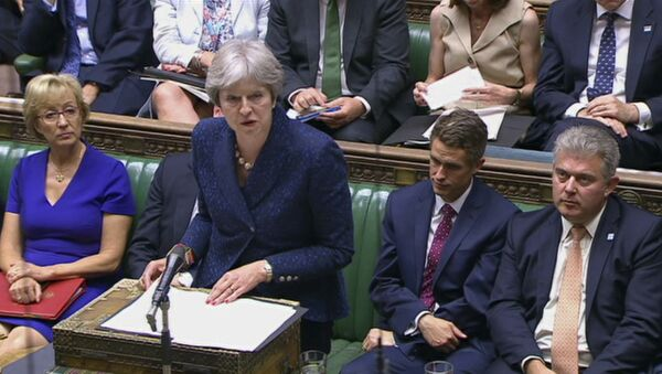 In this image from TV, Britain's Prime Minister Theresa May gives a statement to parliament Monday July 9, 2018. - Sputnik International