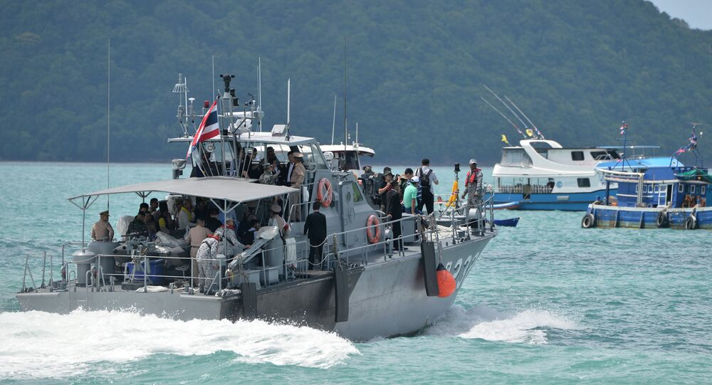 A Thai Royal Navy boat is seen during a searching operation for missing passengers of a capsized tourist boat at a pier in Phuket Thailand, July 7, 2018.