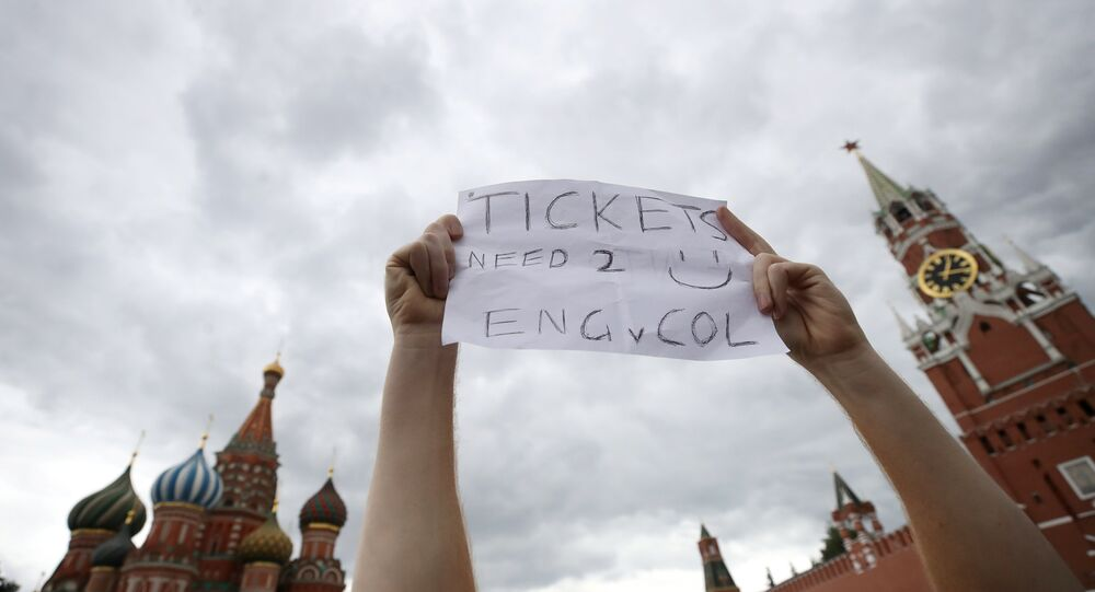 Soccer Football - World Cup - Round of 16 - Colombia vs England - Spartak Stadium, Moscow, Russia - July 3, 2018 England fan holds up a sign asking for tickets before the match in Red Square