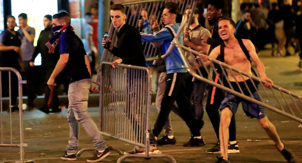 Soccer Football - World Cup - Semi-Final - France vs Belgium - Paris, France, July 11, 2018 - France fans with barriers clash on the Champs-Elysees after their World Cup semi-final match