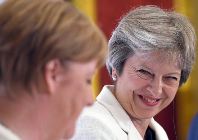 Britain's Prime Minister Theresa May, and Germany's Chancellor Angela Merkel hold a news conference with Polish Prime Minister, Mateusz Morawiecki (unseen) during the Western Balkans Summit 2018 at Lancaster House in London, Britain, July 10, 2018