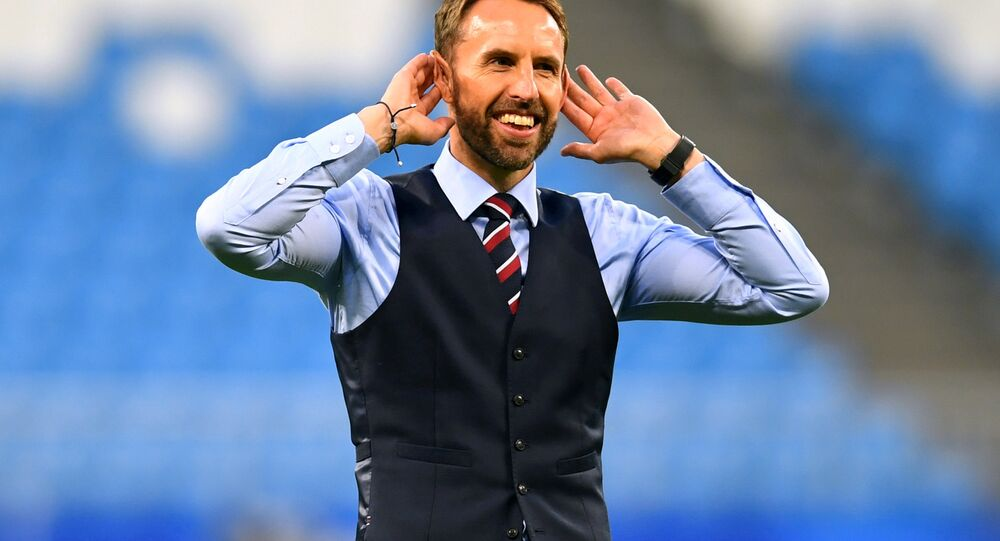 England manager Gareth Southgate salutes their fans after the match.