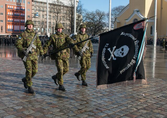 Military officers march during a military parade to celebrate 100 years since Estonia declared independence for the first time in 1918, in Tallinn on February 24, 2018
