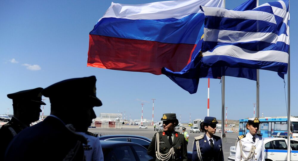 FILE PHOTO: Greek police and army officers stand by Greek, Russian and EU flags as they wait for the arrival of Russian President Vladimir Putin in Athens, Greece airport, May 27, 2016.