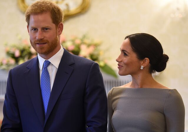 Britain's Prince Harry and his wife Meghan, Duchess of Sussex, smile as they prepare to meet Ireland's President, Michael Higgins, on their second day of a two-day visit to Dublin, Ireland July 11, 2018