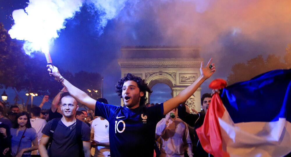 Soccer Football - World Cup - Semi-Final - France vs Belgium - Paris, France, July 10, 2018 - France fans react on the Champs-Elysees after defeating Belgium in their World Cup semi-final match
