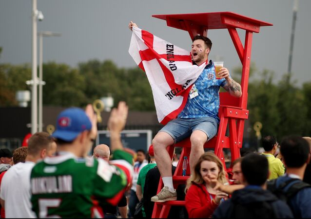 England's fan cheers waiting for the World Cup semifinal soccer match between Croatia and England, outside the Luzhniki stadium, in Moscow, Russia, July 11, 2018.