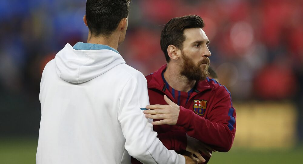 Barcelona's Lionel Messi, right and Real Madrid's Cristiano Ronaldo greet each other before a Spanish La Liga football match between the two teams, dubbed 'El Clasico', at the Camp Nou stadium in Barcelona, Spain, Sunday, 6 May 2018.