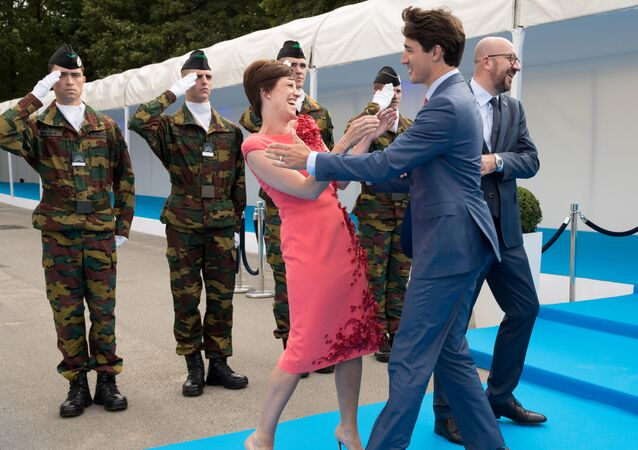 Belgian Prime Minister Charles Michel, his partner, Amelie Derbaudrenghien, and Canada's Prime Minister Justin Trudeau during the arrival for a dinner at the Parc du Cinquntenaire - Jubelpark park in Brussels, Belgium July 11, 2018
