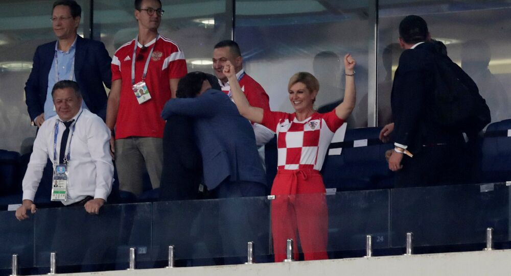 Soccer Football - World Cup - Quarter Final - Russia vs Croatia - Fisht Stadium, Sochi, Russia - July 7, 2018 Croatia president Kolinda Grabar-Kitarovic celebrates in the stand after winning the penalty shootout