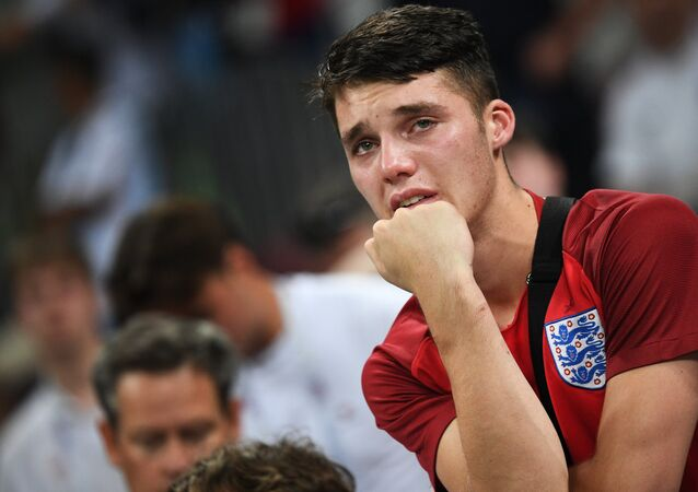 Dejected England's fan reacts after team's 1-2 loss at the World Cup semifinal soccer match between Croatia and England, at the Luzhniki stadium, in Moscow, Russia, July 11, 2018.