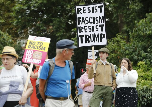 Protesters against the visit of US President Donald Trump gather near an entrance to the US ambassador's residence Winfield House in Regents Park in London on July 12, 2018
