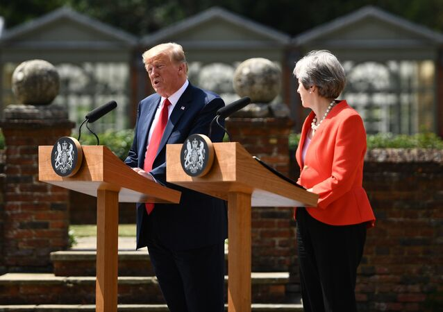 US President Donald Trump (L) and Britain's Prime Minister Theresa May hold a joint press conference following their meeting at Chequers, the prime minister's country residence, near Ellesborough, northwest of London on July 13, 2018 on the second day of Trump's UK visit