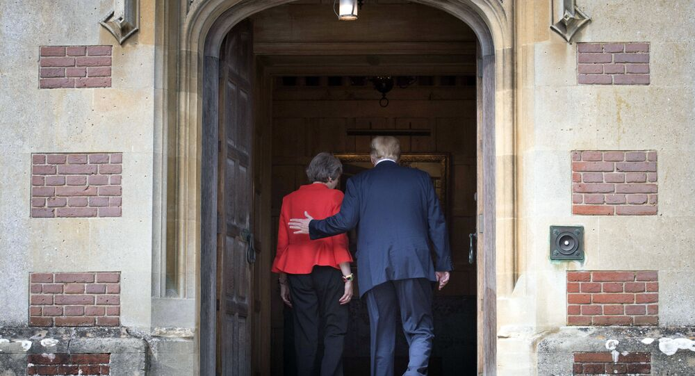 British Prime Minister Theresa May greets U.S President Donald Trump before their meeting at Chequers, in Buckinghamshire, England, Friday, July 13, 2018.