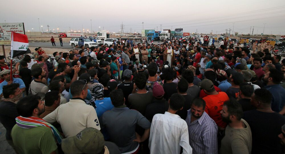Protesters block the road to Iraq's Umm Qasr port, south of Basra, Iraq July 13, 2018.