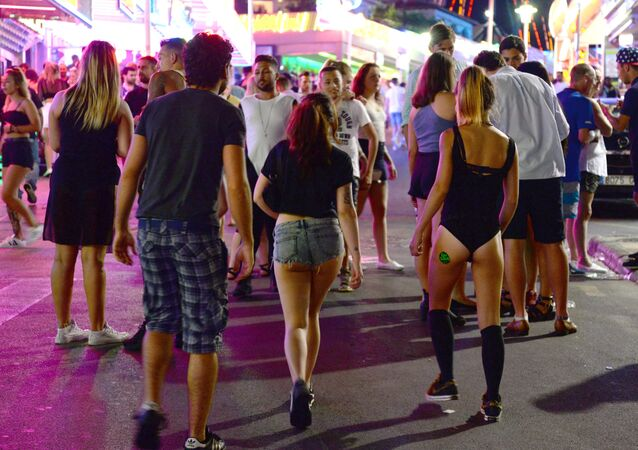 Tourists walk on the street at the resort of Magaluf (File)