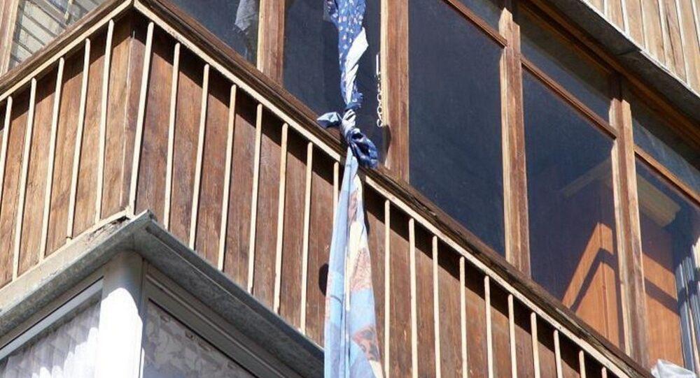 Sheet hangs from a window