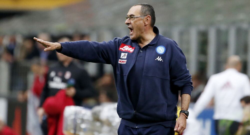 Napoli coach Maurizio Sarri gives instructions during the Serie A soccer match between AC Milan and Napoli at the San Siro stadium in Milan, Italy, Sunday, April 15, 2018