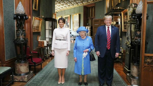 Britain's Queen Elizabeth stands with U.S. President Donald Trump and his wife, Melania in the Grand Corridor during their visit to Windsor Castle, Windsor, Britain July 13, 2018 - Sputnik International