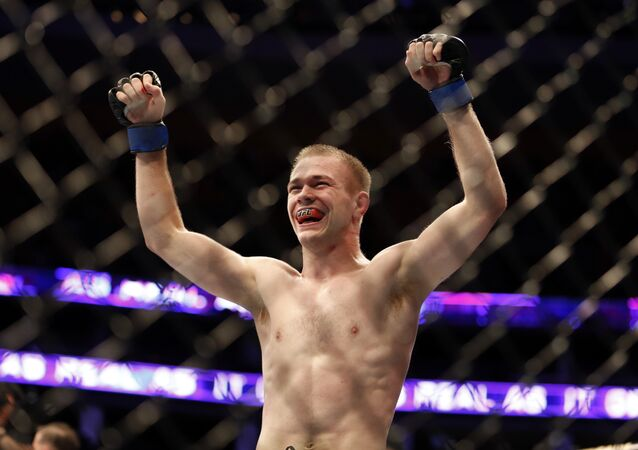 Michael McDonald celebrates a win against Brad Pickett after their UFC on Fox Sports 1 mixed martial arts bout in Boston, Saturday, August 17,2013