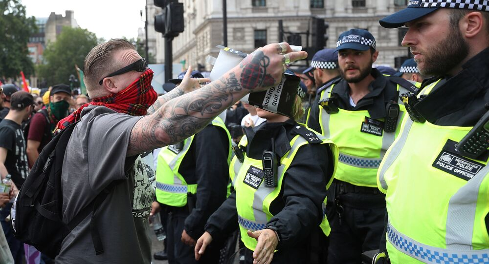Supporters of English Defence League founder Tommy Robinson are confronted by police officers as they demonstrate in London, Britain July 14, 2018.