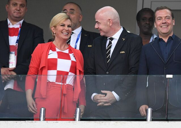 Russian Prime Minister Dmitry Medvedev and President of the Republic of Croatia Kolinda Grabar-Kitarović are on the stand during the 2018 FIFA World Cup quarterfinal match between the national teams of Russia and Croatia. Center: FIFA president Gianni Infantino