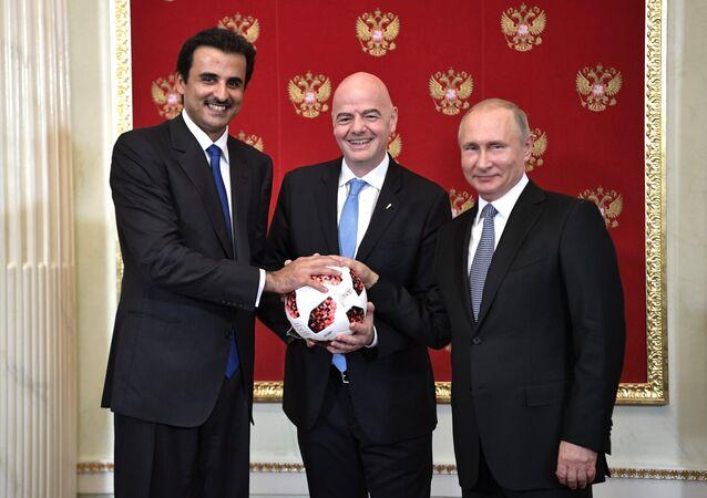 Putin Passes Symbolic FIFA World Cup Baton to Qatari Emir