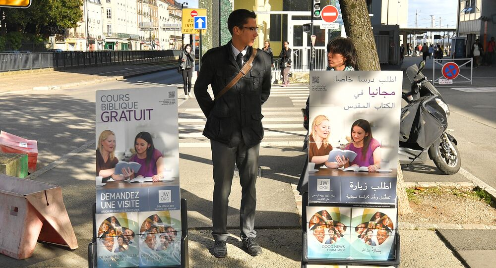 Members of the Jehovah's Witnesses display brochures on October 20, 2017 in Nantes, western France