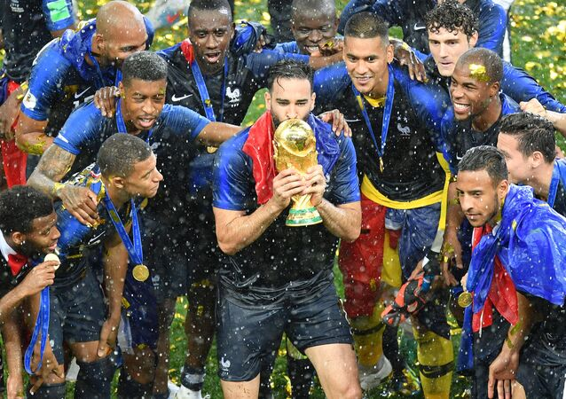 France's players celebrate with the Trophy after winning the World Cup final soccer match between France and Croatia at the Luzhniki stadium, in Moscow, Russia, July 15, 2018