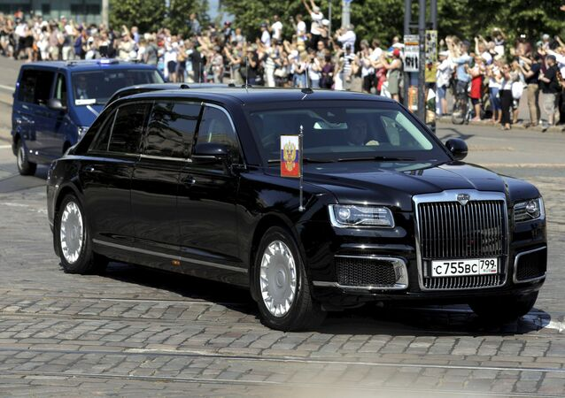 The motorcade and Kortezh limousine carrying the President of the Russian Federation Vladimir Putin pass the Finnish Parliament in Helsinki, Finland July 16, 2018