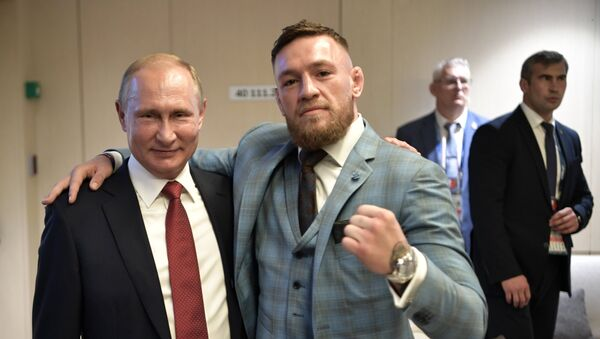 Russian President Vladimir Putin and Irish mixed martial artist Conor McGregor, right, during the break in the 2018 FIFA World Cup final match between the national teams of France and Croatia at Luzhniki Stadium - Sputnik International