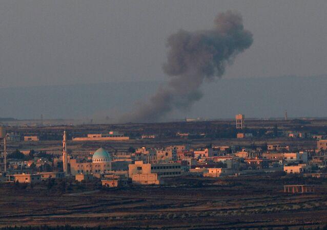 Smoke rises from Quneitra area, Syria July 15, 2018