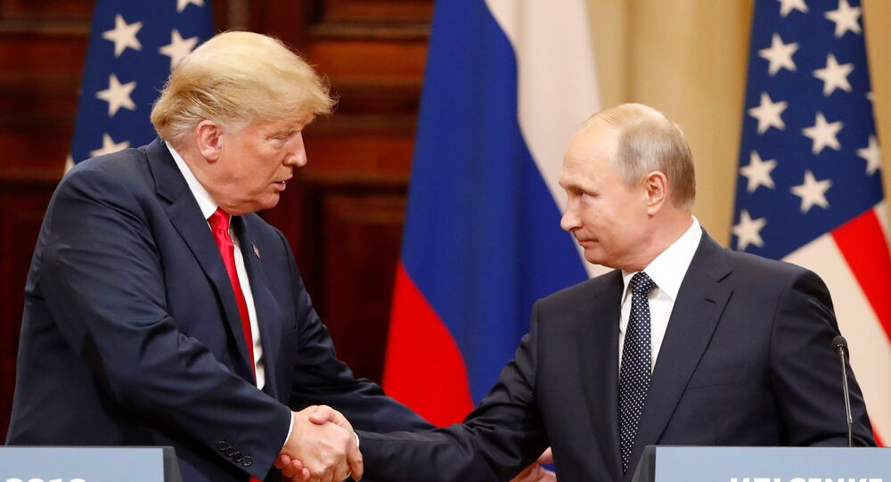 U.S. President Donald Trump and Russian President Vladimir Putin shake hands as they hold a joint news conference after their meeting in Helsinki, Finland July 16, 2018. REUTERS/Grigory Dukor
