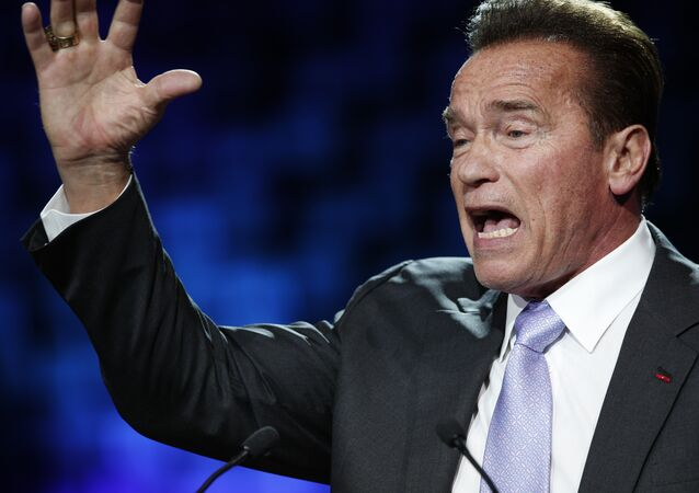 Former California Gov. Arnold Schwarzenegger delivers his speech at the One Planet Summit, in Boulogne-Billancourt, near Paris, France, Tuesday, Dec. 12, 2017. World leaders, investment funds and energy magnates promised to devote new money and technology to slow global warming at a summit in Paris that President Emmanuel Macron hopes will rev up the Paris climate accord that U.S. President Donald Trump has rejected