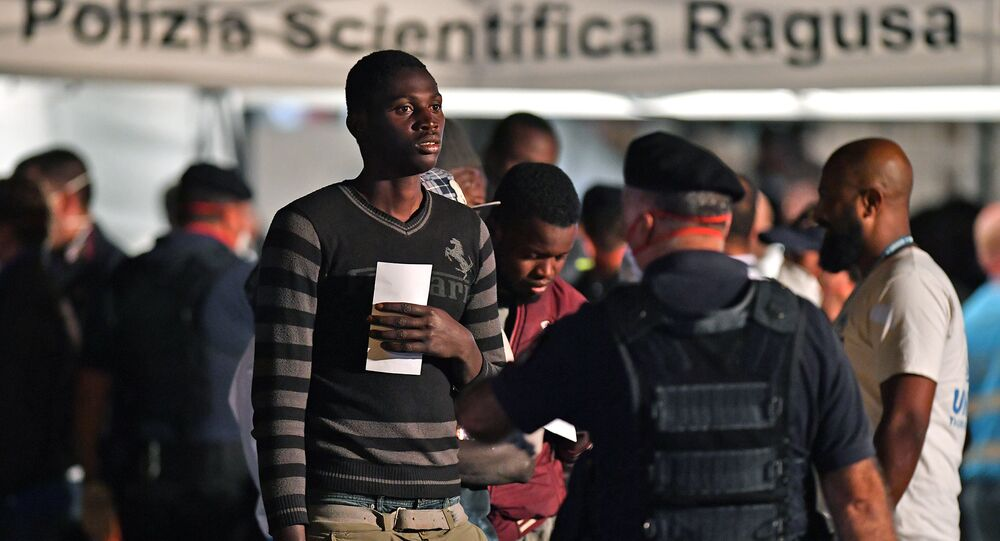 A migrant is pictured after disembarking from the Italian Coast Guard vessel Diciotti at the port of Pozzallo, Sicily on June 19, 2018, following a rescue operation of migrants and refugees at sea
