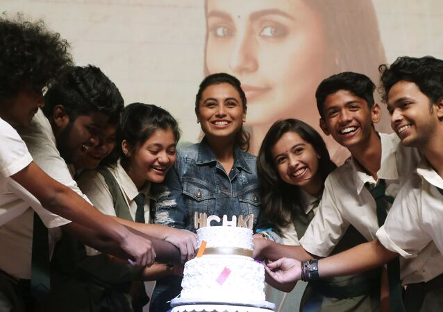 Indian Bollywood actress Rani Mukherji (C) takes part during a promotional event for the Hindi film 'Hichki' in Mumbai on March 29, 2018