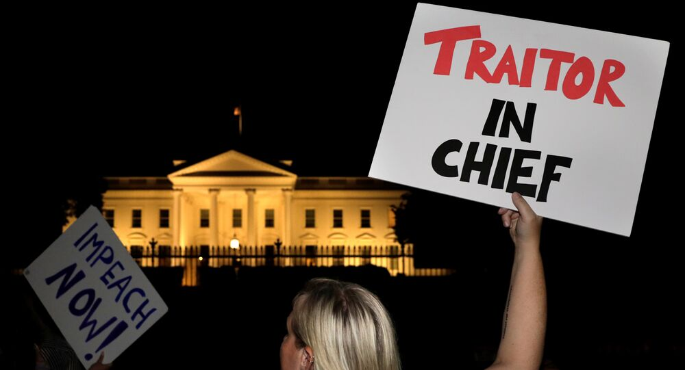 Protesters rally outside the White House in Washington, U.S. on July 16, 2018 after U.S. President Donald Trump's return from Helsinki, Finland