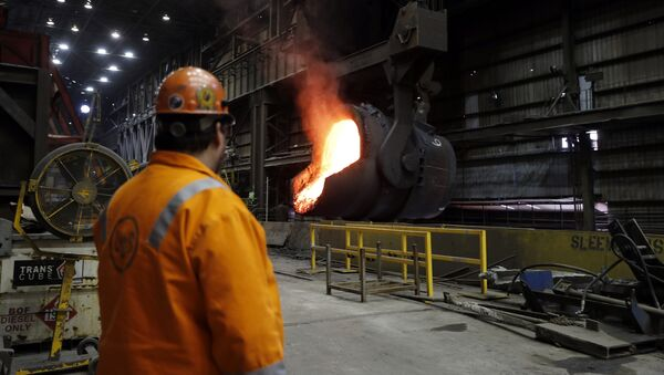In this Thursday, June 28, 2018, file photo senior melt operator Randy Feltmeyer watches a giant ladle as it backs away after pouring its contents of red-hot iron into a vessel in the basic oxygen furnace as part of the process of producing steel at the U.S. Steel Granite City Works facility in Granite City, Ill. - Sputnik International