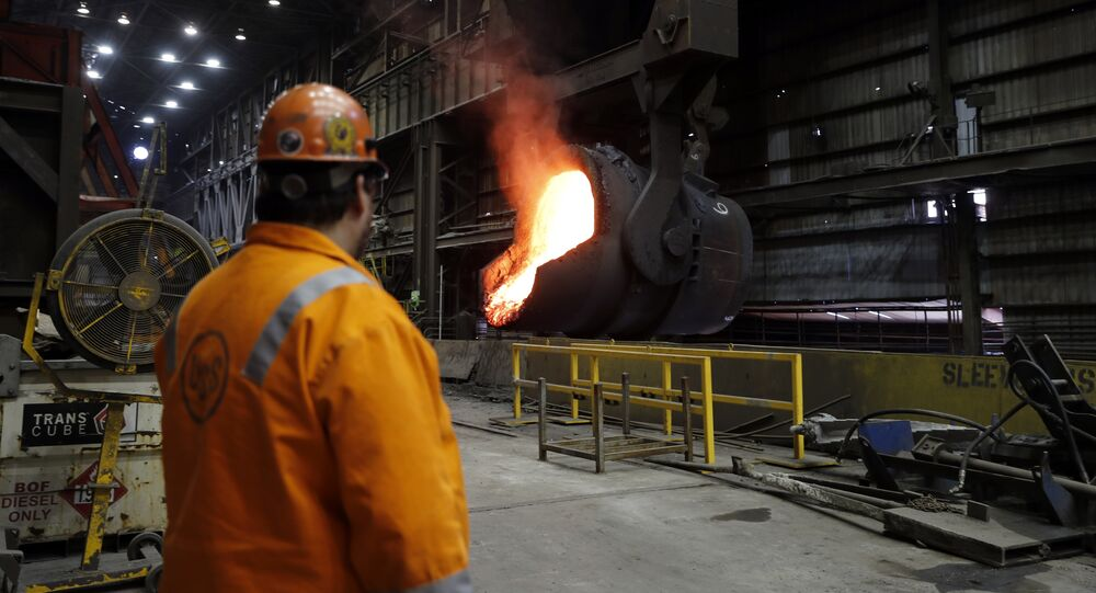 Senior melt operator Randy Feltmeyer watches a giant ladle as it backs away after pouring its contents of red-hot iron into a vessel in the basic oxygen furnace as part of the process of producing steel at the US Steel Granite City Works facility in Granite City, Ill. File photo