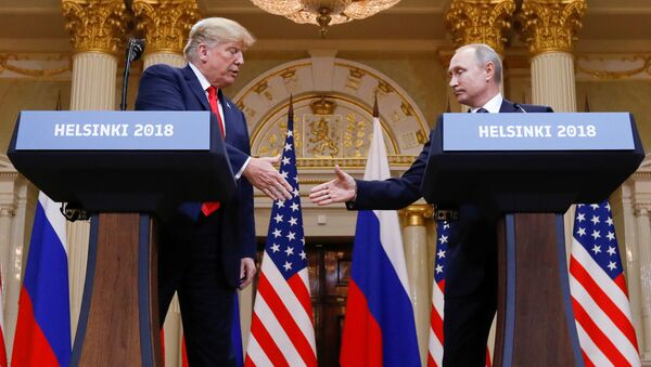 U.S. President Donald Trump and Russia's President Vladimir Putin shake hands during a joint news conference after their meeting in Helsinki, Finland, July 16, 2018 - Sputnik International