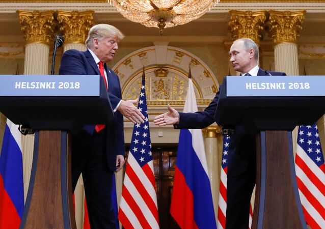US President Donald Trump and Russia's President Vladimir Putin shake hands during a joint news conference after their meeting in Helsinki, Finland, July 16, 2018