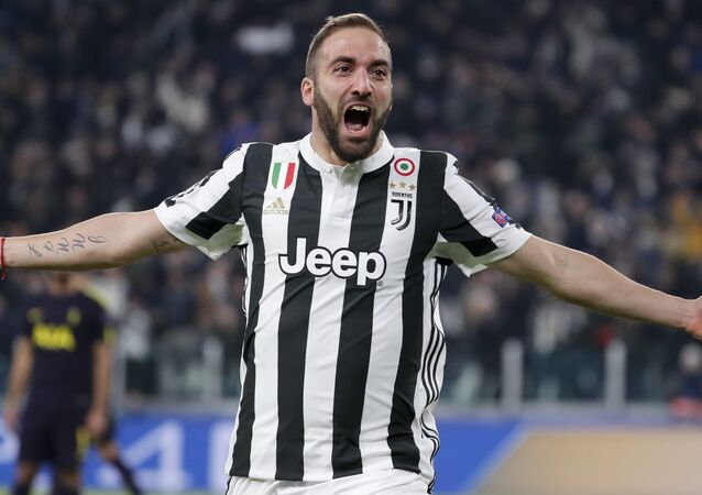 Juventus' Gonzalo Higuain celebrates after scoring his side's opening goal during the Champions League, round of 16, first-leg soccer match between Juventus and Tottenham Hotspurs, at the Allianz Stadium in Turin, Italy, Tuesday, Feb. 13, 2018.